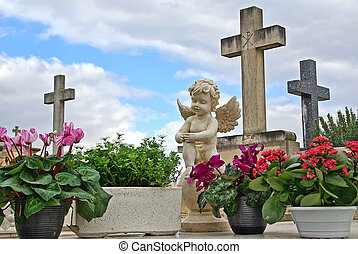 Cemetery Angel - Statue of an angel boy located in a...