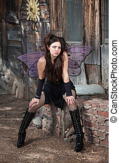 Fairy Relaxes - Sexy fairy relaxes in rustic scene with...