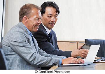 Colleagues working together on a computer