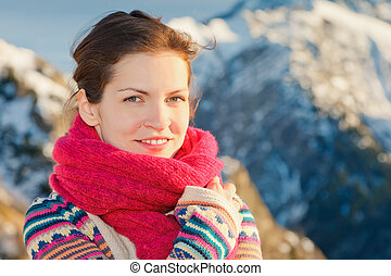 Attractive girl in winter Alps