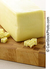 mozzarella cheese block made from fresh milk and used in...
