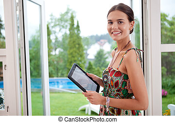 Woman holding tablet pc - Attractive young woman holding...