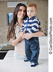happy mom and son together at home