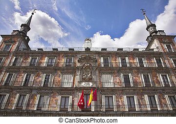Building of municipality in Madrid decorated by flags