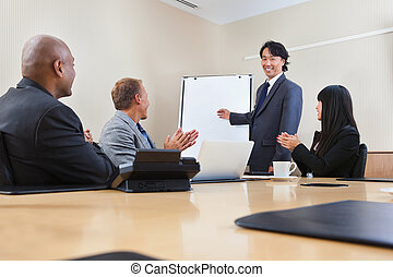 Man giving a presentation to associates