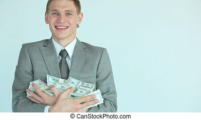 Man with money - Businessman holding a heap of dollar bills...