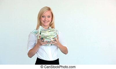 Profit - Pretty blonde showing dollar bills in her hands