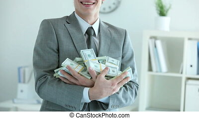 Successful businessman - Businessman holding a heap of...