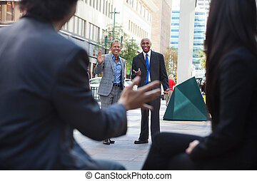 Business People Greeting Each other - Business people waving...