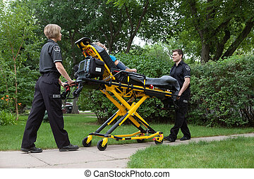 Emergency Medical Team - Medical team transporting patient...