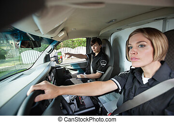 Female EMS Professional in Ambulance - Two female EMS...