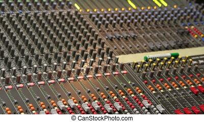 controls of dj music mixer close-up