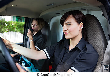 Female Paramedic Driving Ambulance