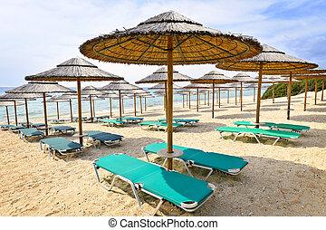 Beach umbrellas on sandy seashore