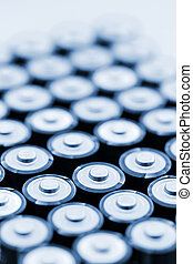 Batteries in array - Tops of many AA batteries in closeup