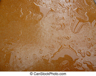 water droplets on a tile - water droplets on a brown...