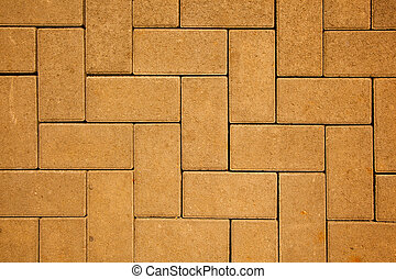 pavement pattern made with cast concrete blocks in yellow...
