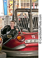 Bumper Cars - A young boy driving a bumper car