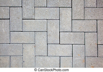 pavement pattern made with cast concrete blocks in grey...