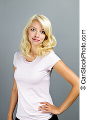 Young blonde woman standing - Portrait of young blonde...
