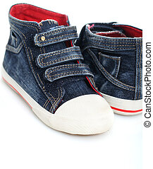 Two jeans sport shoes of a child over white
