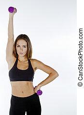 Fitness Model - A brunette fitness model preparing to work...