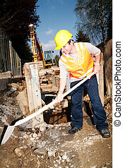 digging - Close-up of a worker digging at building site