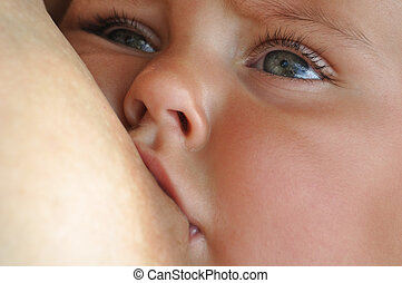 breastfeeding - mother feeding her baby with breast milk