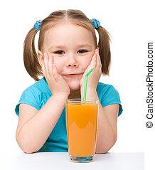 Little girl drinks orange juice - Cute little girl drinks...