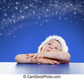Little boy looking up to starry night sky - Little boy...
