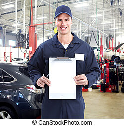 Auto mechanic. - Auto mechanic in auto repair shop. Garage.