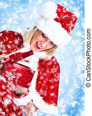 Santa girl with gift. - Beautiful santa woman with gift....