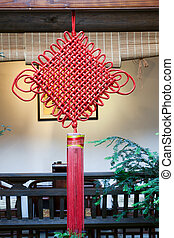 Chinese festal knotting hanging on wooden beam