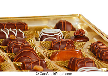 Sweets from a black and white chocolate in a box