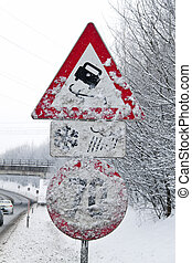 snowy road signs - a snowy road signs skidding in winter