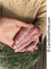 Young and senior holding  hands