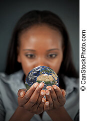 Woman holding the Earth