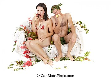 nude couple eating apple - nude funny couple sitting on...
