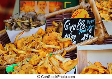 a lot of chanterelles at market