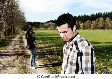 divorce - sad man standing aside from woman with baby,...
