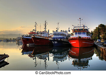 Fishing boats on early morning on calm sea - Fishing boats...