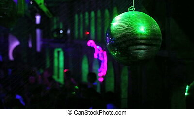 Disco ball on the nightclub background