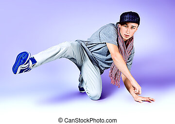 professional - Young man dancing hip-hop at studio