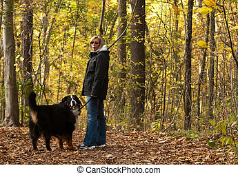 Older Woman walking dog