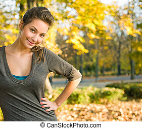 Beautiful young brunette in autumn park - Beautiful young...
