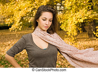 Fall fashion girl with flowing scarf. - Portrait of fall...