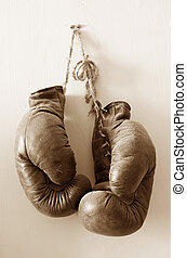 Hang up the gloves, collecting dust. - hang up the gloves,...