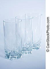 Decorative drinking glasses shot in cool blue filtering.