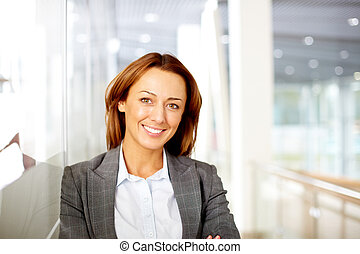 Happy female - Portrait of happy businesswoman looking at...