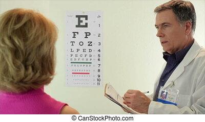 Optometrist having his patient read
